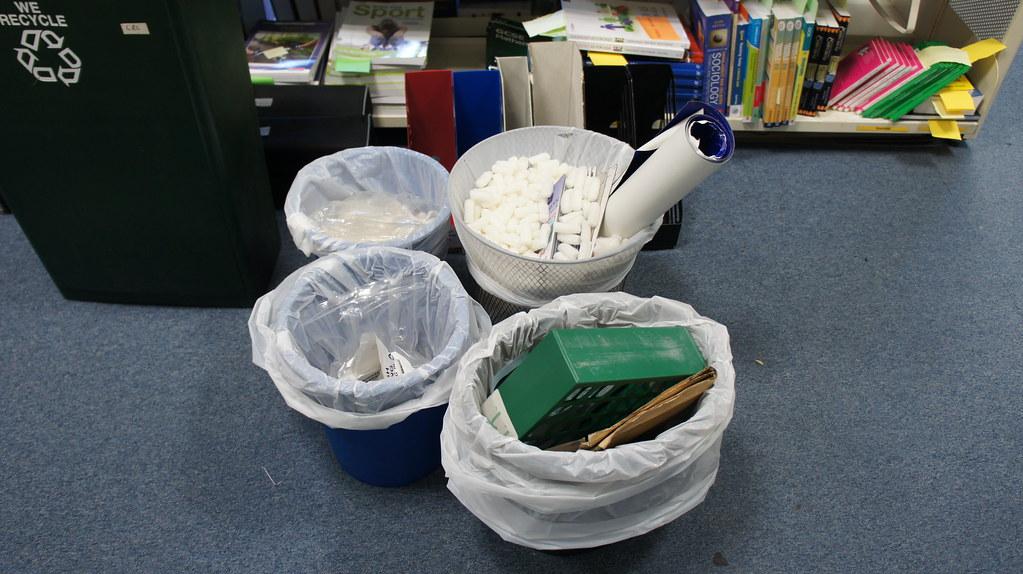 four bins of rubbish