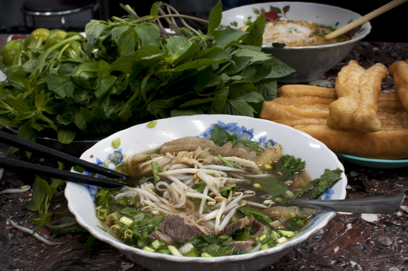 Can pho be a reason to travel to a place?  Of course!  Vietnam has long since been on my list of places to visit, one of those reasons was to taste pho from its source.  Pho Goa is heavily lauded by many travel books and website the place serves up a good bowl of pho, but the real treat is the Chinese bread.  This was my first time with pho and the dipping bread.  Other establishments need to pick up on this little nugget of goodness.