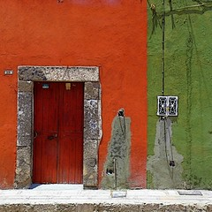 scarred (msdonnalee) Tags: door house architecture facade buildings casa arquitectura puerta stonework masonry sidewalk doorway architektur mexique porte orangeandgreen fachada entry mexcio mexiko messico  woodendoor facciate arqitetura   photosfromsanmigueldeallende mexicancolornialarchitecture magicunicornverybest magicunicornmasterpiece fotosdesanmigueldeallende larqitecture