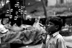 Bubbles (Prashanthe) Tags: park playing love childhood children happy solitude joy memories content bubbles national bannerghatta 70300mm soapbubbles childlabour conscience fulfilled blackwhitephotos canon550d groundofjoy