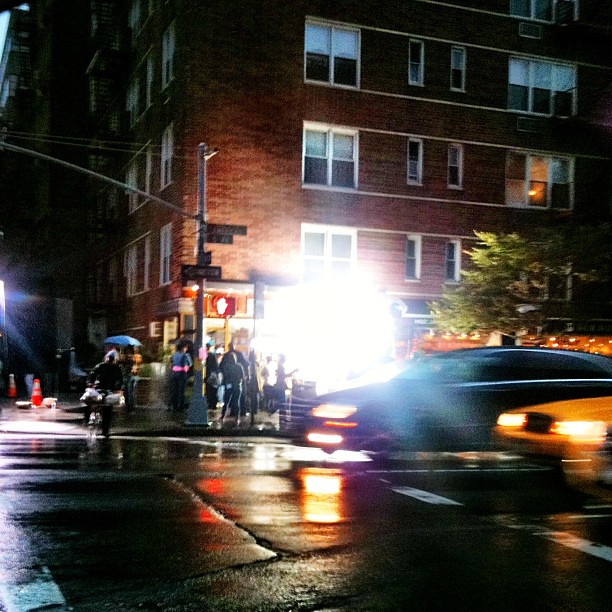 Filming in the rain on 6 av