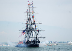 USS Constitution fires a 21-gun salute toward Fort Independence on Castle Island during the ship's July 4th underway as part of Boston Harborfest (Official U.S. Navy Imagery) Tags: heritage boston colonial navy maritime fourthofjuly sailor mass usnavy ussconstitution 21gunsalute bostonharborfest july4thunderway