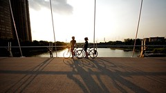 Sunset Goodbyes (Roger Cullman) Tags: sunset summer toronto bicycle cycling togetherness shadows wide bikes romance goodbye humberbridge pedestrianbridge superwide TGAM:photodesk=wide