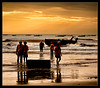 on a quest for their daily bread.. (PNike (Prashanth Naik..back after ages)) Tags: life sea india fish beach water silhouette sunrise bread fishing fisherman workers nikon asia daily orangesky activity tides struggle goldenhour vizag anchored visakhapatnam livelyhood d7000 pnike