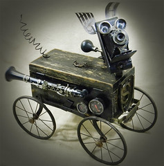 STANLEY STEAMPUNK - The Hero Of The Highway Robot Dog Assemblage - Reclaim2Fame (Reclaim2Fame) Tags: wood sculpture black metal robot assemblage mixedmedia machine buggy foundobject steampunk robotassemblage vintageobject steampunksculpture steampunkrobot steampunkdog steampunkmachine