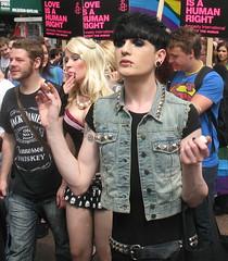 love is a human right (jackeeadio) Tags: ireland gay pierced woman man tattoo candid belfast northernireland earrings smoker studs ulster amnestyinternational denimwaistcoat belfastgayprideparade2011