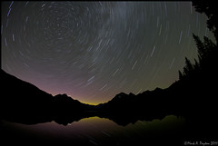 Star-Trails over Bowman Lake (Mark Payton) Tags: lake reflection night canon stars eos montana mt glacier fisheye 1ds 15mm startrails polaris timedexposure canon1ds eos1ds bowmanlake canonef15mmf28fisheye markpayton glaciernatinalpark missoulaphotographer markpaytonphotography