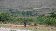 A lady with a very strong neck...(KENYA) (vermillion$baby) Tags: africa international kenya people road fun trail path highwaysandroads active activity electric wire urban pole girder telephone electrical telephonepole african highway wild powerline pylon tower poles