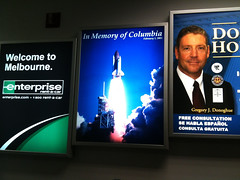 Columbia Memorial Billboard over Baggage Claim