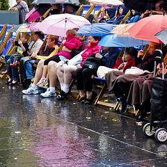 Singing in the rain (Paul J White) Tags: monument rain newcastle toystory spnp outdoorfilms pauljwhite danceinthestreet munemwasif streetphotographynowproject