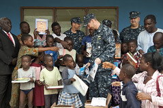 Sailor hands out school books to children in Nigeria. (Official U.S. Navy Imagery) Tags: navy sailors lagos nigeria sailor usnavy comrel apswest
