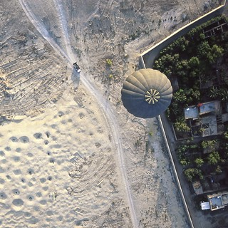 a balloon crosses the fine line between arid desert and lush oasis