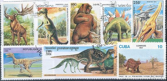 Známky - 25 rôznych, praveké zvieratá - dinosaury