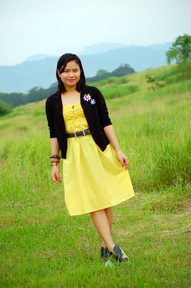 yellow dres and black cardigan