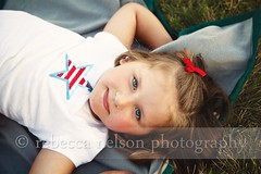 (Rebecca812) Tags: blue red white holiday cute girl grass childhood happy star child sweet blueeyes innocent content ground celebration blanket 4thofjuly lying canon5dmarkii whatgettywants rebecca812 heritage2011