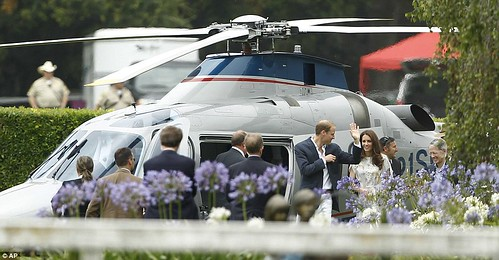Kate Middleton keeps it simple in a fresh and floral dress as she and Prince William mingle with celebrities at charity polo match  8