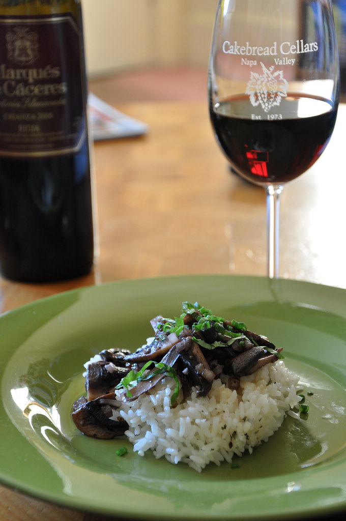 wine-sautéed mushrooms and velouté sauce on rice