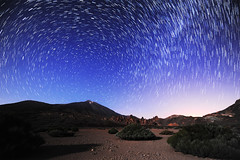 The stars were dancing just for me (c@rljones) Tags: longexposure sky mountains night dark stars landscape volcano desert crater tenerife astronomy canaryislands shrubs cosmos turning outofthisworld swirly twisty milkyway startrail mountteide
