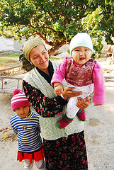 UZB-Fergana-0810-551-v1 (anthonyasael) Tags: road wood family winter two portrait people woman baby 3 tree cute love girl smile face hat smiling vertical kids mouth children asian happy person one three sweater kid clothing bed holding women asia warm child open adult affection muslim central daughter mother silk knit happiness wear relationship parent single portraiture charming care chubby uzbekistan fergana examine making generation mid carry hold carrying lovable relation ouzbekistan a ozbekiston ozbekstan