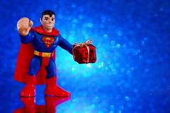 Gifted Hero (JD Hancock) Tags: birthday blue favorite comics fun toy actionfigure action bokeh superman cc gift figure scifi present comicbooks portfolio dccomics char onblue theotherside inkitchen jdhancock