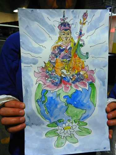 Watercolor of Padmasambhava, Buddhist teacher of the World, White Tara's lotus, held by a volunteer backstage preparing for the mandala offering to His Holiness 14th Dalai Lama of Tibet, Kalachakra for World Peace, Verizon Center, Washington D.C., USA by Wonderlane