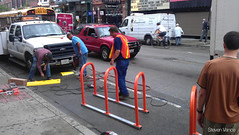 Installing the Tuff Curb (Steven Vance) Tags: road street orange wickerpark bicycling design wpb transportation bikerack ssa roadway dero milwaukeeavenue bikeparking bikecorral wickerparkbucktown onstreetbikeparking ssa33 bikeparkingcorral bikechi wpbrides