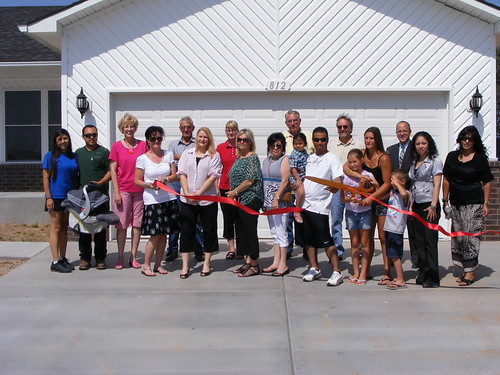 USDA Rural Development staff, Liberal Self-Help participants and City of Liberal officials celebrate the completion of the self-help homes.