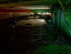 crows underbelly (MM ) Tags: longexposure shadow red reflection green spider stream web pipe drain burn culvert overflow playingwithlight wallsend runoff lowlevel northtyneside