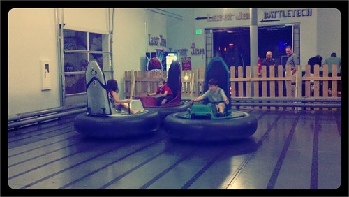 Judah anna and Thomas are having fun on bumper cars