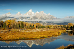 An autumn view of the Grand Tetons [#2 Explored on 13-07-2011] (Dennis Rademaker) Tags: park blue autumn mountain snow black mountains color fall water colors yellow us view grand scene jackson explore national wyoming tetons naturesfinest interestingness7 supershot explored dennisrademaker