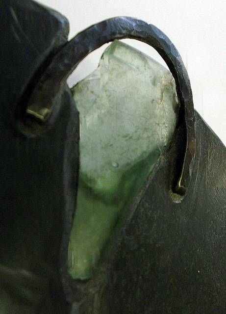 Raw detail: unearthed bottle glass, forged stainless steel