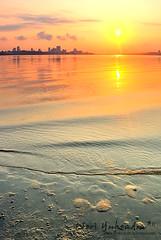 Pantai (W E R I) Tags: city sunset sea sky sun tree beach water yellow clouds sunrise singapore reservoir kranji reser d80