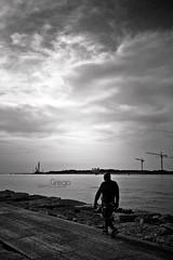 Tra cielo e mare (Alberto Grego Photography ) Tags: venice light sea sky italy canon eos blackwhite mare uomo cielo terra luce biancoenero controluce chioggia 24105 veneto diga sottomarina canon7d