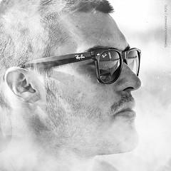 Smoke   Matteo (tg   photographer) Tags: boy portrait white man black cute guy face glasses model eyes cigarette smoke smoking occhi uomo bianco ritratto nero viso rayban ragazzo occhiali fumo sigaretta modello