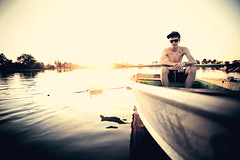Setting Sun & Setting Sail (Andy S. Foster) Tags: lighting light boy sunset ohio summer portrait sun lake man reflection male andy water fashion yellow canon lens outdoors 50mm prime golden evening boat back student pond warm sailing photographer angle natural mark f14 wide paddle dramatic alec s shades row canoe glossy foster teen ii commercial shelby teenager sail ambient editorial and l 5d series backlit mm setting tones roe 1740 mansfield oipt