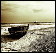 a brief moment... when time stood still.. (PNike (Prashanth Naik..back after ages)) Tags: old bridge sea sky woman india bird beach water grass lady vintage bay pier boat sand nikon crow andh