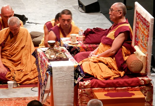 From his short throne with table, orange & maroon robes, His Holiness the 14th Dalai Lama blessing the Kalachakra mandala in preparation for the Initiation, Namgyal monks and lamas, string still connected,  Kalachakra for World Peace, Washington D.C., USA by Wonderlane