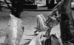 Streets of Dhaka : High Spirit (Shutterfreak ☮) Tags: poverty life street distortion girl monochrome fun garbage nikon mood happiness rope lakeside telephoto hanging pan dhaka pavementdweller inkiad