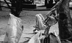 Streets of Dhaka : High Spirit (Shutterfreak ) Tags: poverty life street distortion girl monochrome fun garbage nikon mood happiness rope lakeside telephoto hanging pan dhaka pavementdweller inkiad
