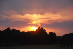 Sunset Gleaming From Under Clouds (ZVMII) Tags: nc sunsets greensboro summerevenings