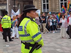 Merseyside Police officer keeps watch (sab89) Tags: lady cop citymerseysidestreet liverpoolgaypride2011merseysidepoliceofficerwomenparaderadio