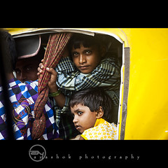 Jam Packed (ayashok photography) Tags: auto road boy india girl yellow children nikon transport ds varanasi trafficjam ki traffice kv autorickshaw kasi saranath nikond40 nikkor70300mmvr dsc6354 ayashok