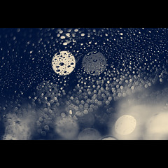 Bokeh-licious (VinothChandar) Tags: blackandwhite bw india window wet water car rain weather canon silver season photography photo droplets drops mercury photos bokeh madras smooth drop rainy monsoon raining chennai liquid plenty climate lots tamilnadu silky liquidsilver lotsofbokeh bokehs silverliquid