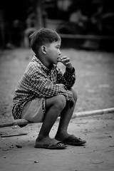 Melancholy (Ty Kong) Tags: boy portrait canon sadness photo cambodge cambodia village child sad market think 7d siem reap enfant