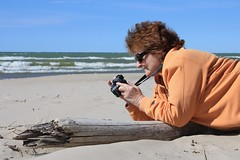 Click!! (Judy Gayle) Tags: camera orange beach water sand driftwood photoshopelements