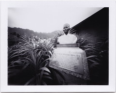 Statue in the Garden (art y fotos) Tags: film polaroid hawaii oahu handmade statues bamboo pinhole kaneohe pack homemade instant fujifilm largeformat bambole busts plaques colorpack peelapart hoomaluhiabotanicalgarden fp100b fujifp100bfilm 325x425 suprememasterchinghai bamboopinholecamera lebambolemkv colorpackpinholecamera