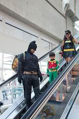 Batman Family Coming Down Escalator (uncle_shoggoth) Tags: robin comics costume san sandiego cosplay diego convention batman batgirl costuming comiccon geeky sdcc