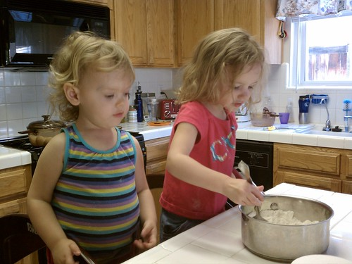 Lily and Livi helping make playdough
