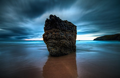 Alone (murphyz) Tags: blue sunset sea beach rock clouds landscape scotland movement sand waves magic hour durness