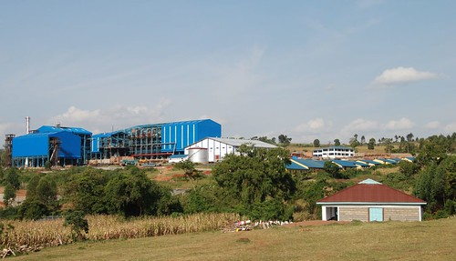The Transmara Sugar Company factory, with its dirty smoke stack and life-sucking water pump dangerously close to the Enkakenya Centre for Excellence dormitory in the foreground.